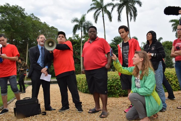 PLN speaks at GEO Group shareholder meeting protest in FL April 2015